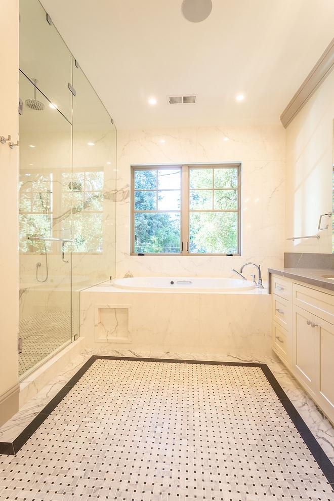 Bathroom Tile Bathroom Floor Tile Bathroom Tiling Bathroom floor tile is a combination of marble basketweave, Absolute Black Granite and Statuario Marble porcelain tile #bathroomtile #bathroomfloortile #bathroomtiling