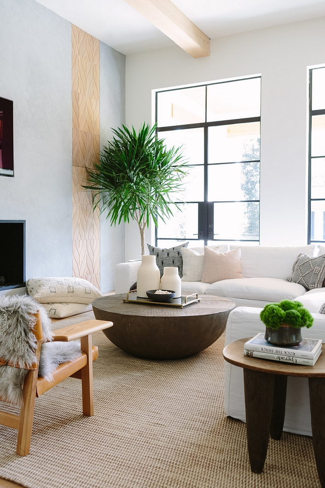 Concrete Fireplace The modern concrete fireplace wall is the centerpiece of the room and features custom designed wood push-paneled doors - that cleverly hide clutter #Fireplace #ConcreteFireplace