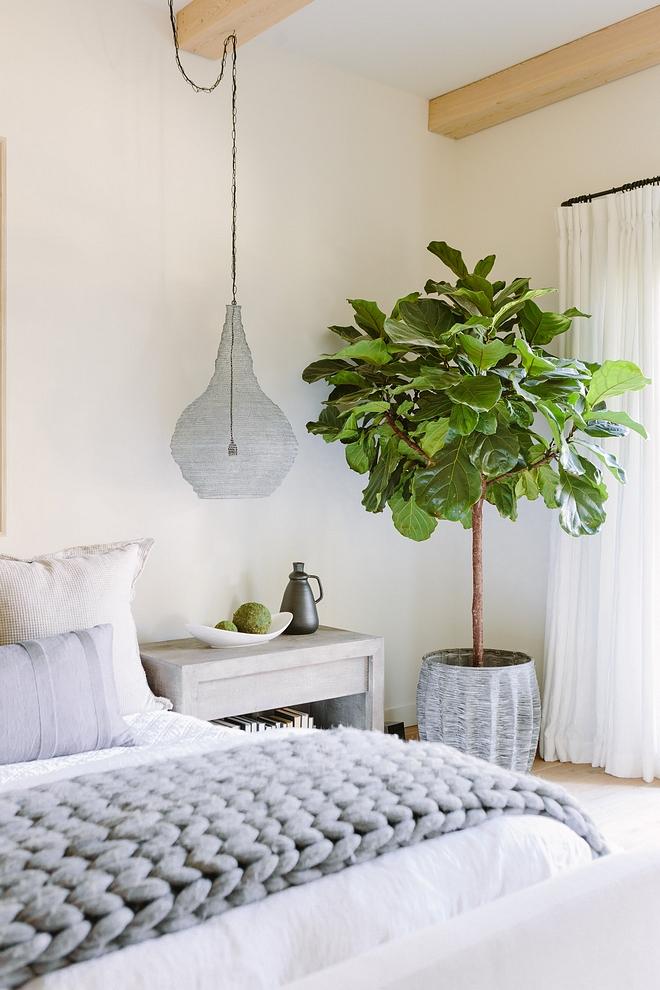 White bedroom eith white an grey color scheme The paint color is Benjamin Moore White Dove #whitebedroom #BenjaminMooreWhiteDove