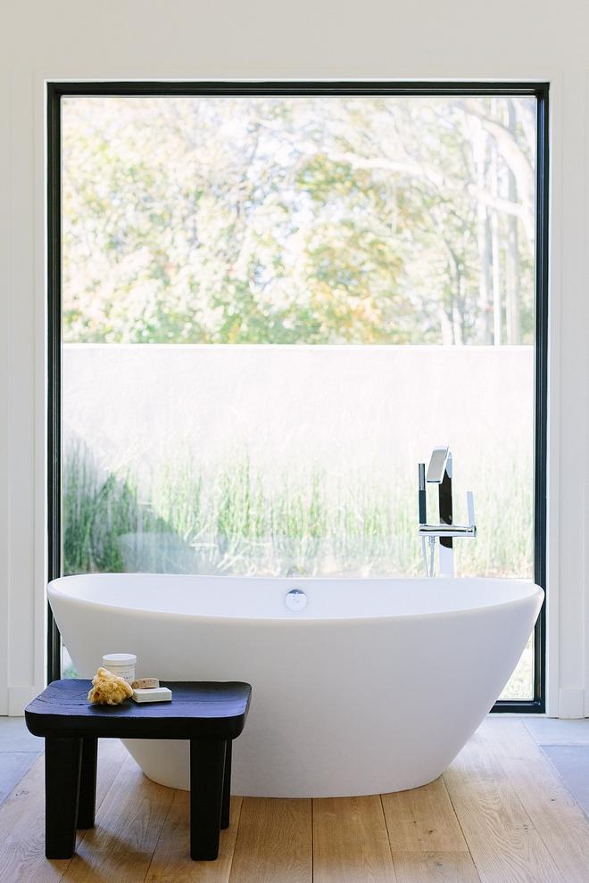 Freestanding tub stool Bathroom with large black steel window, Freestanding tub and a custom black stool Bathroom Freestanding tub stool Freestanding tub stool #Freestandingtub #stool #bathroomwindow