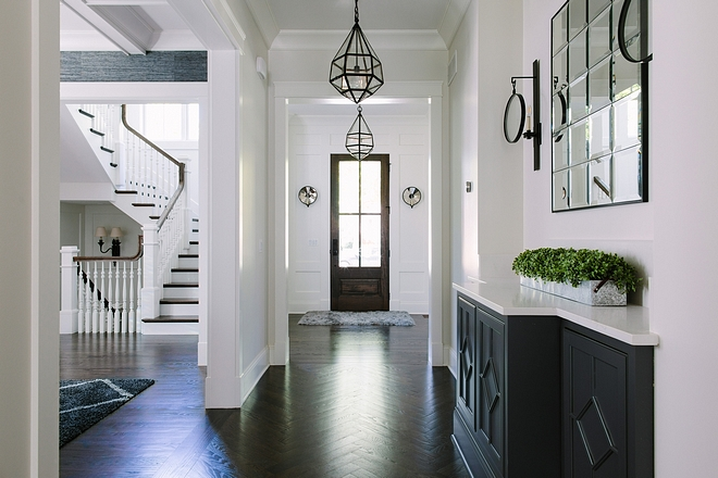 Dark hardwood floors This home comes to show that dark hardwood floors with white wall paneling is a classic choice that will always stand the test of time #darkhardwoodfloors