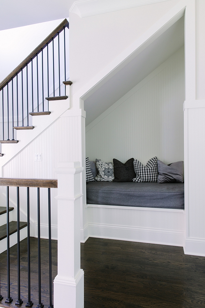 """""""Hang-out Nook"""" under second staircase. Isn't this a brilliant idea?! Wainscoting and trim are painted in Simply White by Benjamin Moore Nook under stair Under stair nook #readingnook #understairnook #nookundertsairs"""