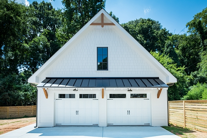 Detached garage Carriage Home Design Beautiful and detailed, from the metal roof overhang, to the cedar brackets, to the doors themselves #Detachedgarage #CarriageHome