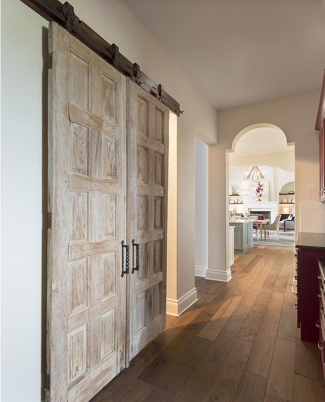 Vintage Doors used as Barn Door Reclaimed Barn Door Handing Vintage Doors with Barn Door hardware #VintageDoors #BarnDoor #ReclaimedBarnDoor #BarnDoorhardware