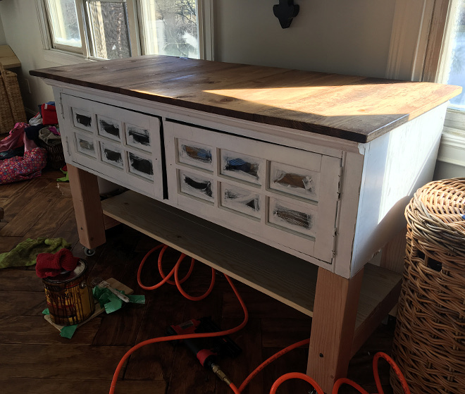 DIY Island We repurposed the old black entertainment center we had into this rolling folding table All details explained on Home Bunch Blog