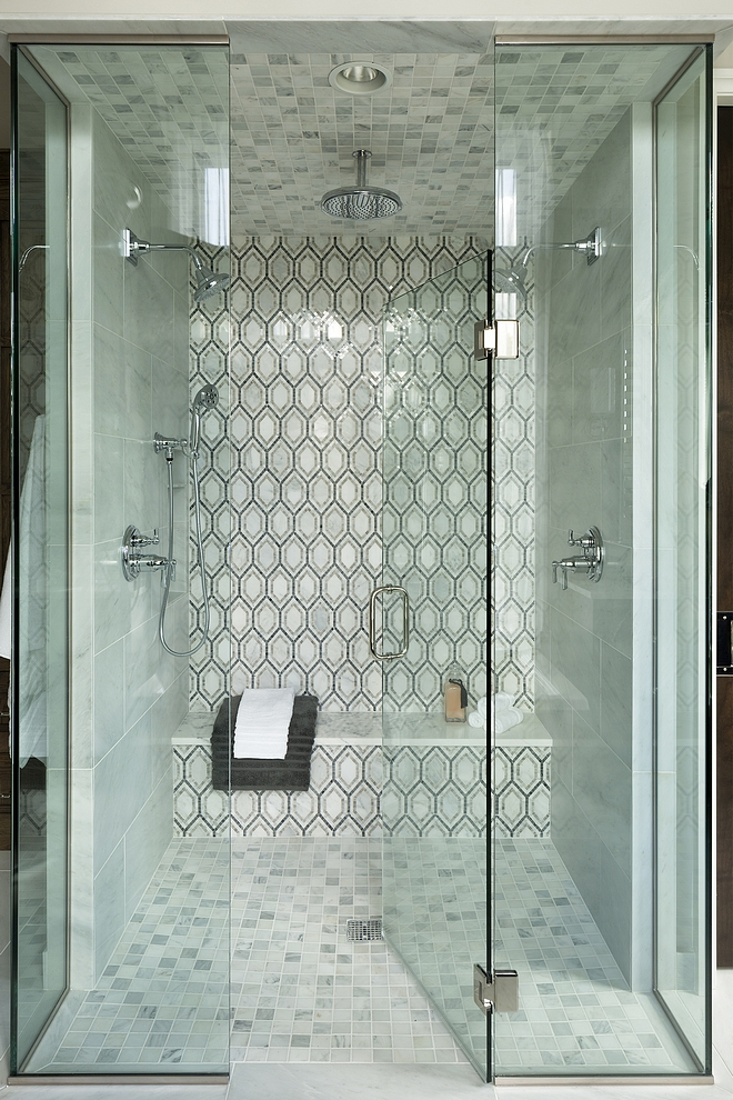 "Shower Sources Shower: 12x24"" Honed Marble Tile.  Shower Floor: 2x2"" Honed Carrara Marble Tile.  Hansgrohe Rain Showerhead.  Kohler Showerheads #showersources #shower #tile"