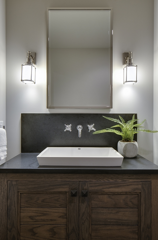 Bathroom features a custom Oak vanity with dark quartz countertop and slab backsplash and a white vessel sink with wall-mount faucet Kohler Purist