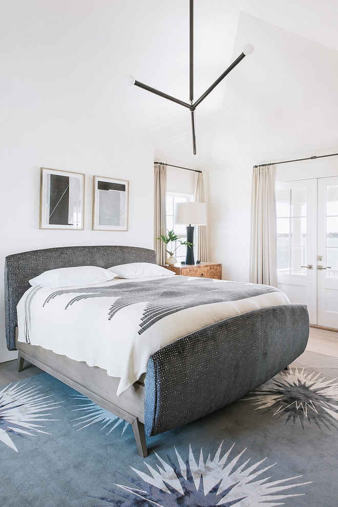 Bedroom Contrasting textures and tones encompass the master bedroom with a velvet upholstered bed, warm burl wood bedside chests, Apparatus lighting, Verellen lamps and a visually impactful rug by Vivienne Westwood #bedroom