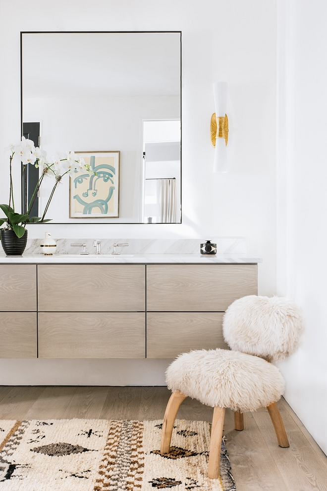 Master bathroom showcases floating cabinetry to match the French Oak floors, Borghini marble countertop #floatingvanity #bathroomvanity #FrenchOak