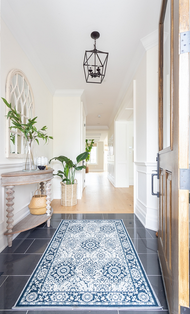 Foyer Tiling Ideas Foyer Tile Combination of tile and continuation with hardwood flooring on the remaining spaces Tile in foyer #FoyerTile #Foyer #Tile #foyertiling