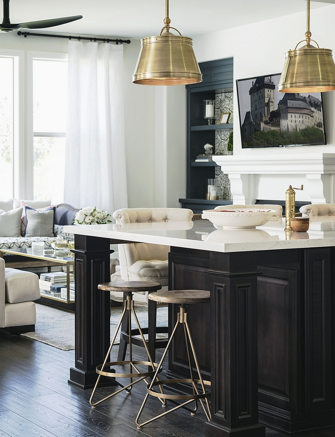 Espresso Stained kitchen island with white marble countertop Classic kitchen island with custom espresso stain color and polished white marble countertop Lighting and counterstool sources on Home Bunch #kitchenisland #darkkitchenisland