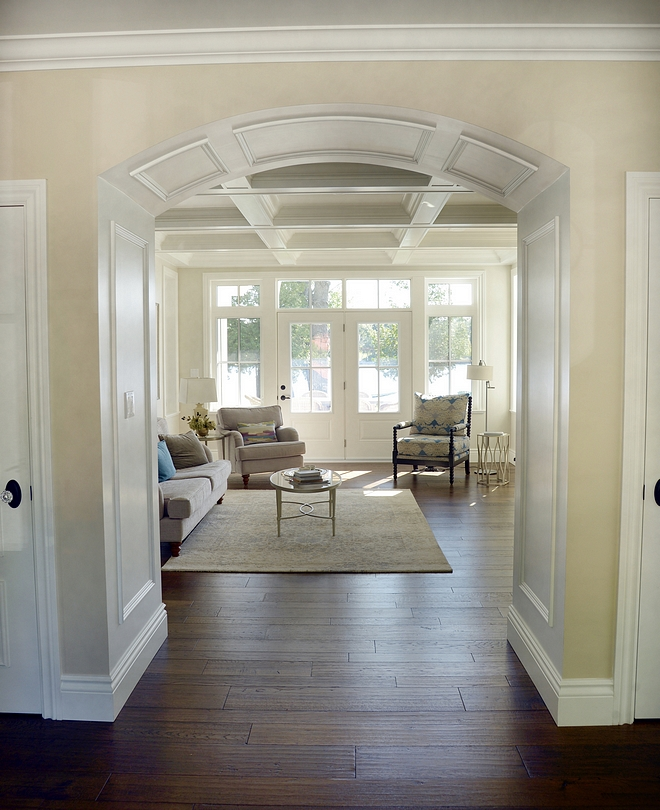 Paneled Archway Archway paneling Archway millwork An archway opens to the living room and frames the lake view #archway #PaneledArchway #Archwaypaneling #Archwaymillwork