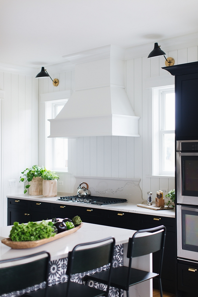 Kitchen Shiplap Backsplash The vertical shiplap along side the elegant fixtures and brass hardware is unexpected but somehow works so beautifully together #kitchne #shiplap #kitchenshiplap #kitchen #shiplap #shiplapbacksplash