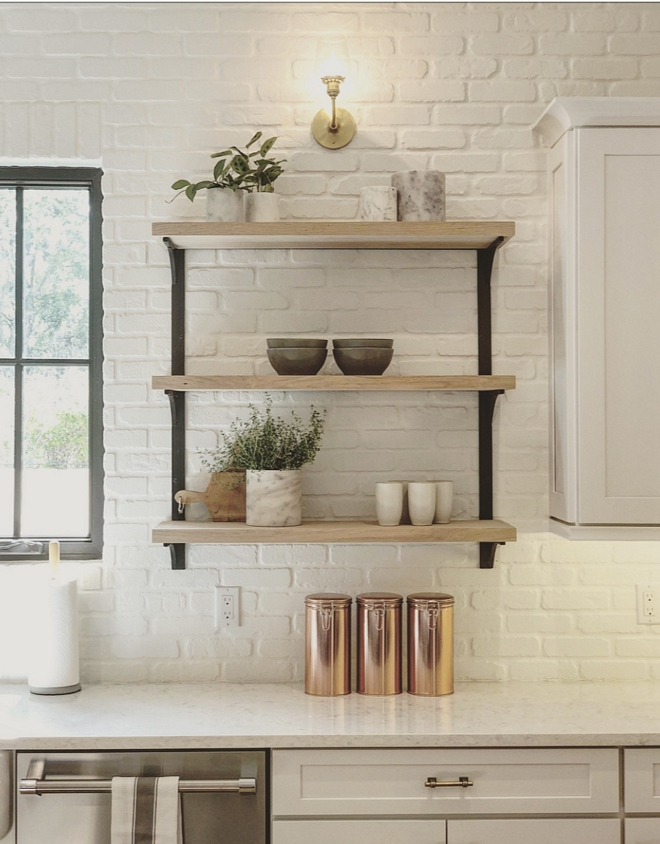 Brick Backplash The backplash is brick and it's painted in Benjamin Moore Simply White The painter added a sealer to keep the brick easy to maintain and clean. Thankfully, this is the type of backplash you can always re-paint it #BrickBackplash