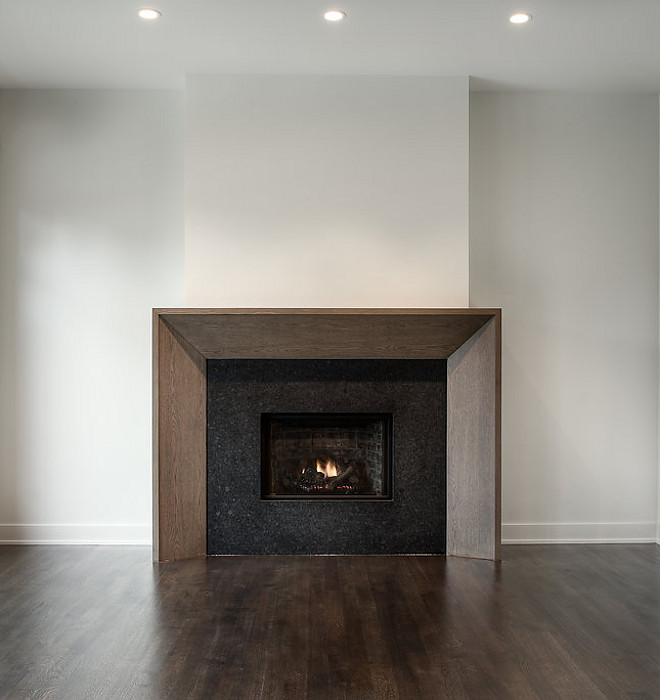 Sleek fireplace design Rough sawn White Oak Trim and Leathered Black Granite #fireplace #RoughsawnWhiteOak
