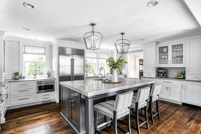White kitchen with grey island This is not a big kitchen but it offers a great layout and plenty of storage and counter space #Whitekitchenwithgreyisland #Whitekitchen #greyisland