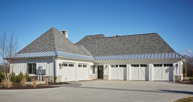 Garage Large Garages Garage for 5 cars This side-entry 5-stall garage is perfectly tucked on the side of the house, not interfering with the architectural details of the facade #largegarages #garage #multiplecargarage #sideentrygarage #5stallgarage