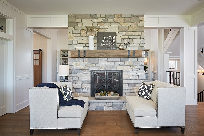 Settes in front of natural stone fireplace with beam mantel #settes #settee #fireplace #beammantel
