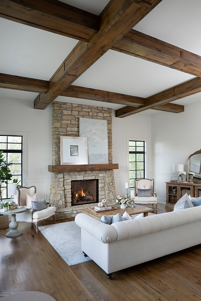 French Country Living room Hardwood flooring is Rustic Hickory planks finished on site The beams are alder and the stone veneer used on fireplace is similar to Montana Quartz #FrenchCountryLivingroom #Hardwoodflooring #beams #stonefireplace #Frenchcountry #interiors #livingroom