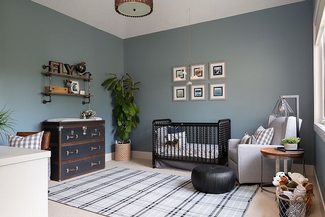 Boys Nursery Boys Nursery with plaid rug, trunk style dresser and spingle crib The whole room was repainted in a steely blue Boys Nursery #BoysNursery