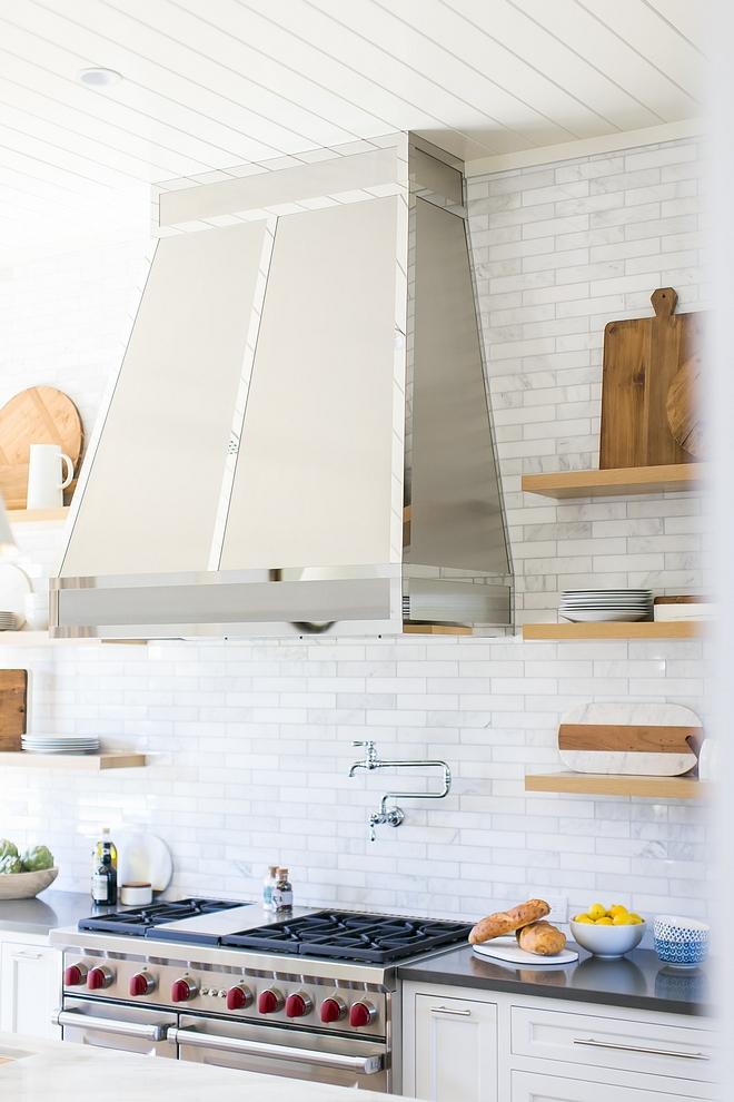 Kitchen Hood custom hood Hood finish is polished Chrome Chrome hood against countert o ceiling white marble subway tile #kitchen #hood #kitchenhood #whitemarblesubwaytile