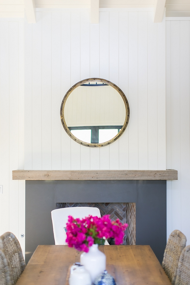 Fireplace Sleek Fireplace A fireplace anchors the informal dining area that separates the living area and kitchen. It features plank walls, a greywashed reclaimed wood mantel and Caesarstone Concrete #fireplace #plankfireplace #reclaimedmantel