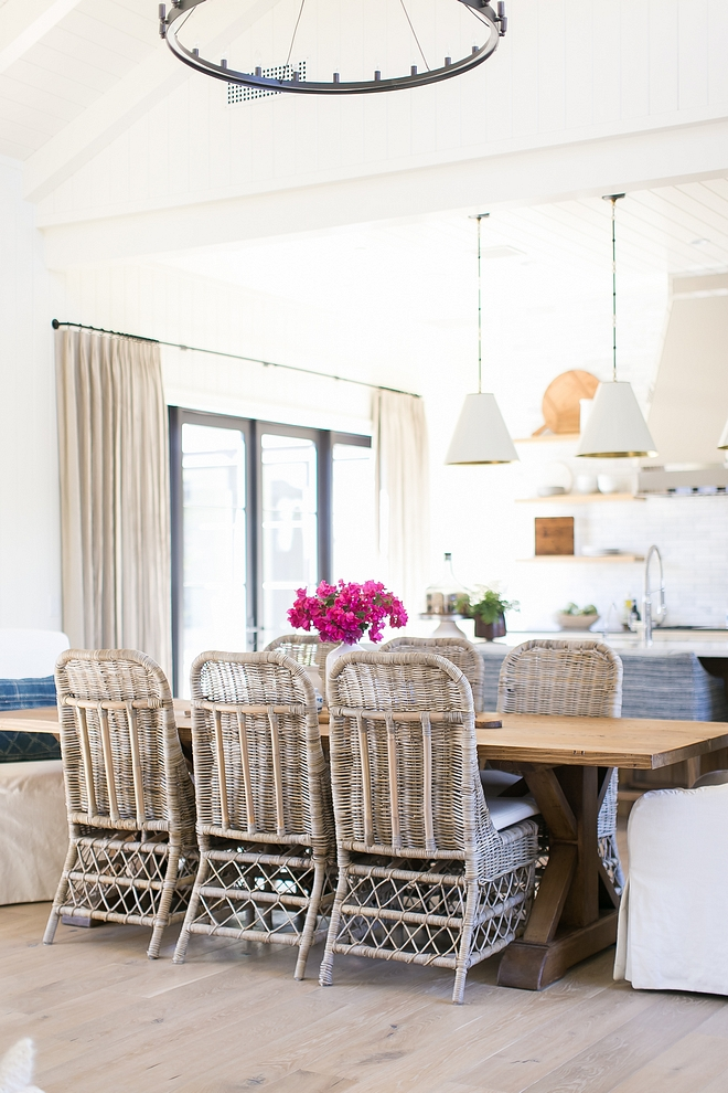 Rattan Dining Side Chairs Rattan Dining Side Chair with white slipcovered host chairs Love this casual combination Rattan Dining Side Chair #RattanDiningSideChair #RattanDiningSChair #DiningChair #SideChair