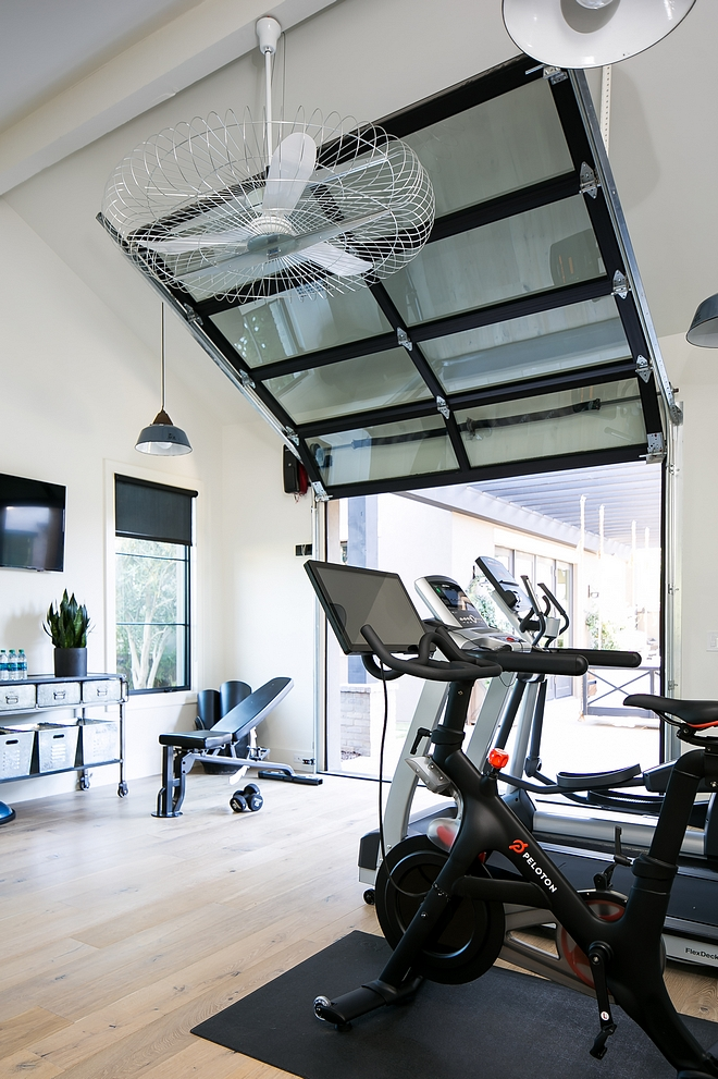 Home gym with glass and steel garage door