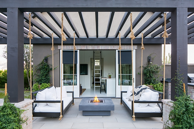 Oversized swing beds hang from pergola Backyard design ideas Oversized swing bed Oversized swing bed #swingbed