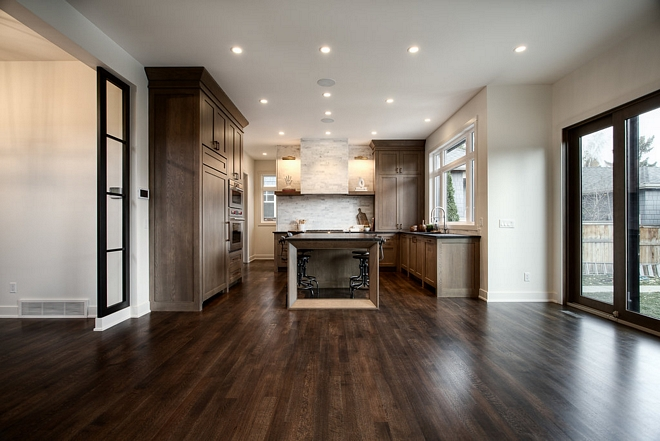 This kitchen features a great layout and a fresh design This is a great alternative if you're tired of painted kitchen cabinets