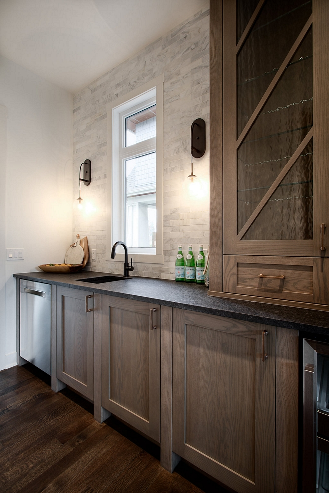 Butlers pantry Rough Sawn White Oak cabinet Rough Sawn White Oak cabinetry To keep a cohesive look, the designer used the same custom Rough Sawn White Oak cabinets #butlerspantry #RoughSawn #WhiteOak #cabinet