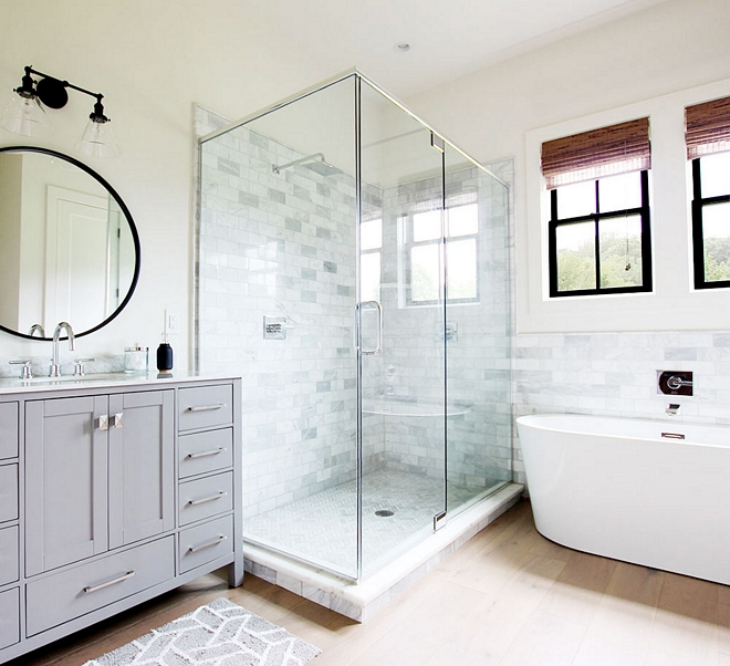 Shower Shower Tile The master bathroom features a large shower with marble subway tile and herringbone floor tile Remaining flooring is hardwood #shower #showertile #whitemarbletile