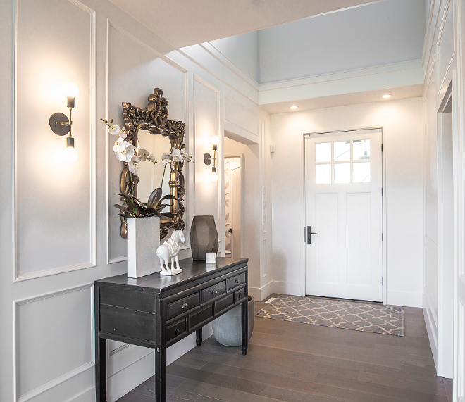 Oxford White by Benjamin Moore Bright foyer with custom paneled walls, painted in Benjamin Moore Oxford White CC-30 Benjamin Moore Oxford White CC-30 #BenjaminMooreOxfordWhite #BenjaminMooreOxfordWhiteCC30