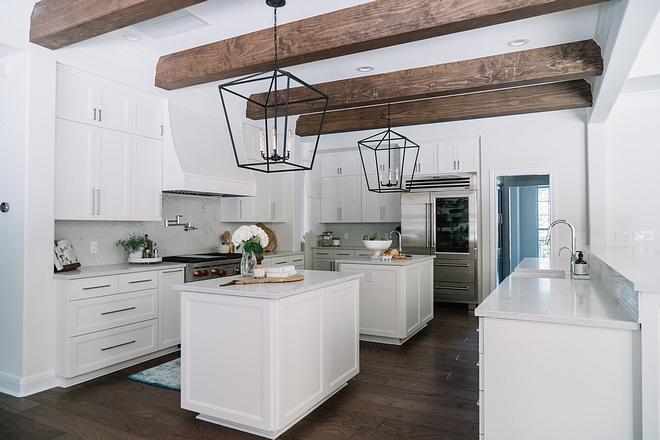 Kitchen with three islands The kitchen features two matching prep-islands and a long island with sink Kitchen with three kicthen islands #Kitchenthreeislands #kitchenislands #kitchenisland #triplekitchenisland
