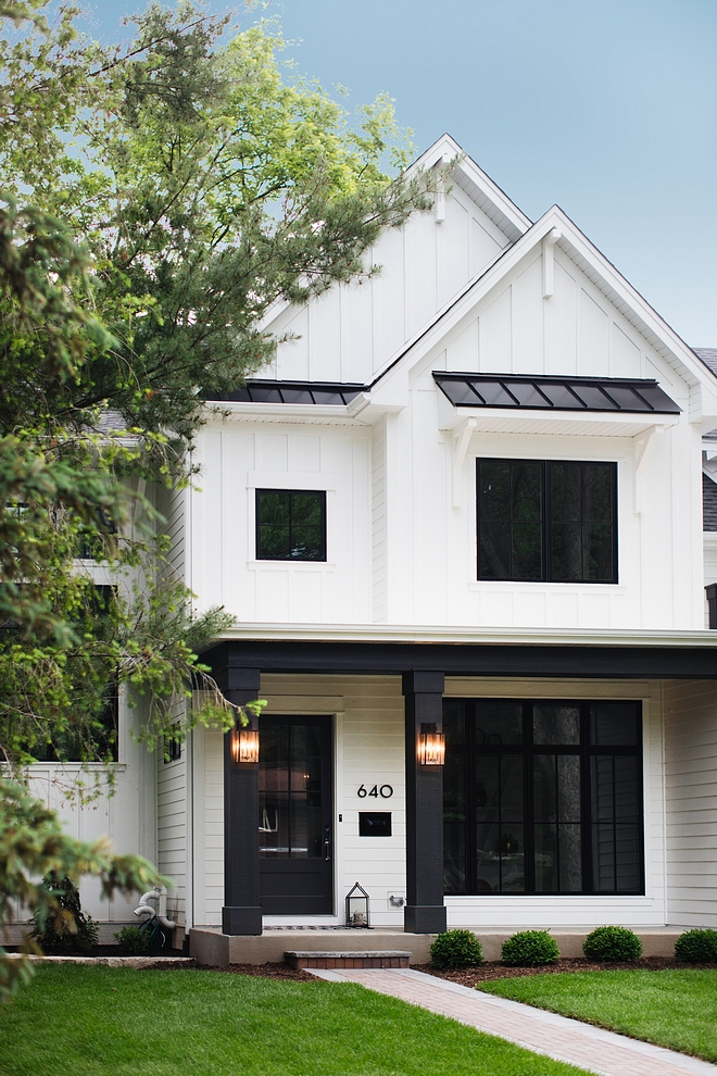 White batten and board exterior with black porch columns, black windows and black metal roof Modern farmhouse White batten and board exterior White batten and board exterior #Whitebattenandboard #whiteexterior #farmhouse #farmhosue #modernfarmhouse