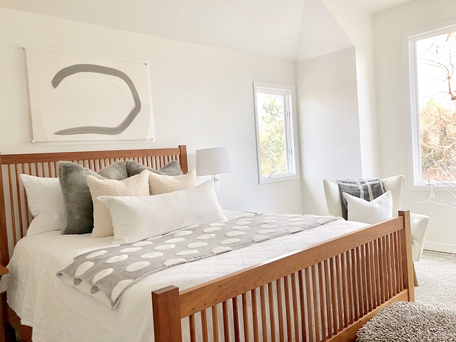 Benjamin Moore Simply White Benjamin Moore Simply White The master bedroom wall is a satin Benjamin Moore Simply White White bedroom paint color Benjamin Moore Simply White #BenjaminMooreSimplyWhite
