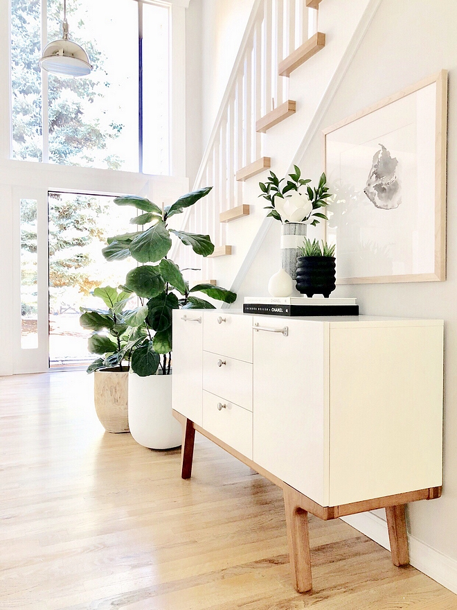Entryway ideas In our entryway we chose to use three large stainless steel pendants that are also in our kitchen, instead of one chandelier. One of the things that we loved when we saw our house for the first time was all the glass and the large window above the front door #entryway