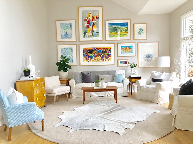 Benjamin Moore Balboa Mist To give the home a modern look and to showcase our art, we picked a warm light gray to paint all the walls in the entire house, Benjamin Moore Balboa Mist #BenjaminMooreBalboaMist