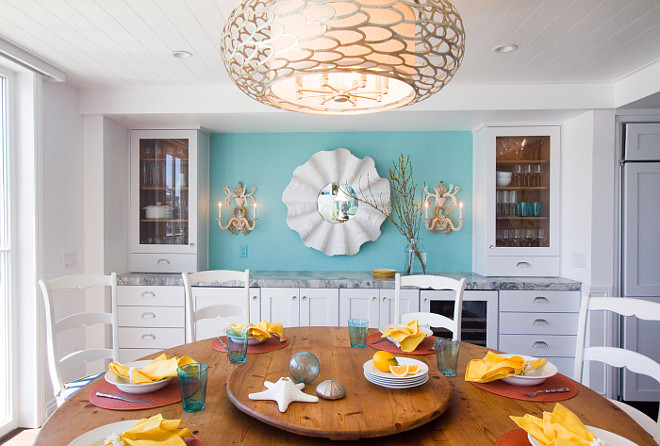Coastal Dining Room This coastal dining room features an inspiring buffet-style cabinet #coastaldiningroom #coastalinteriors #coastalhomes #diningroom