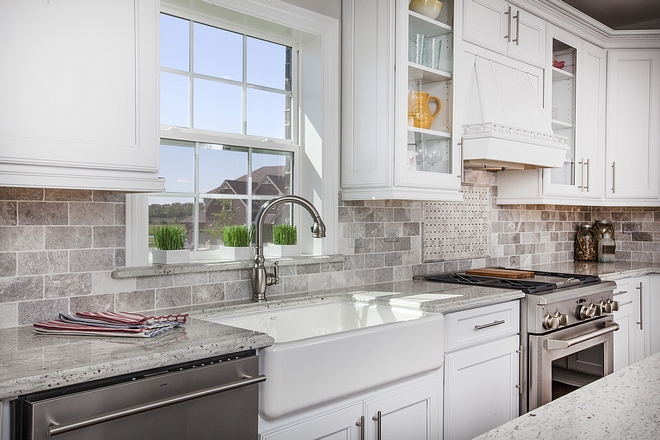 White kitchen with tumbed backplash tile and white granite countertop #kitchen #backsplash #countertop
