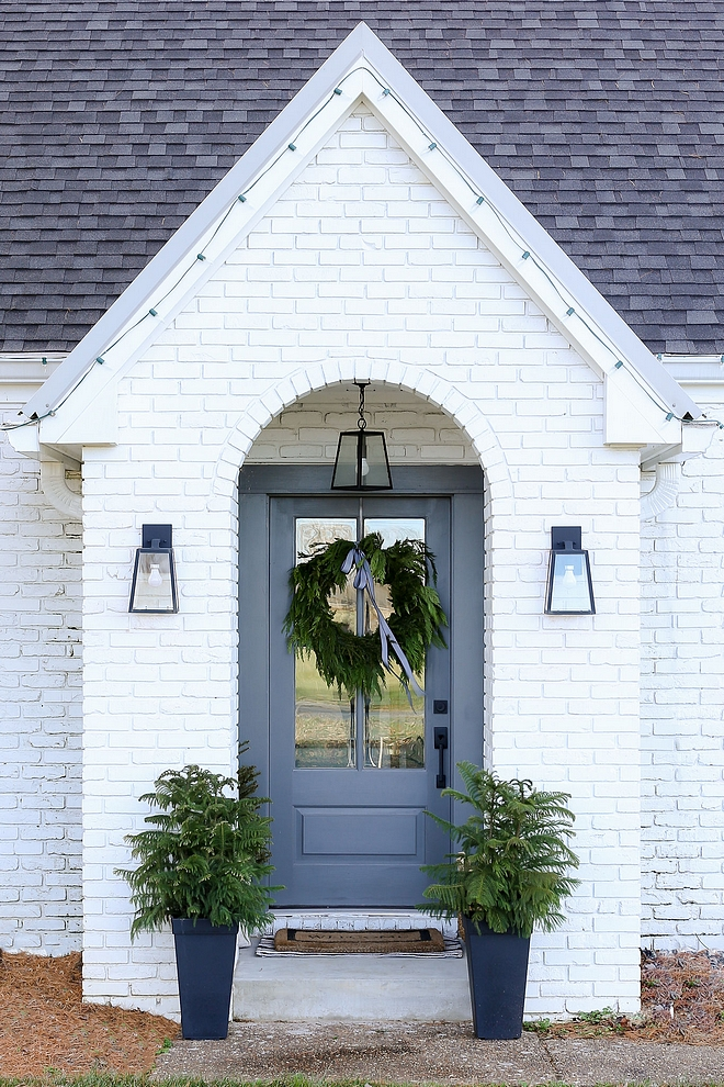 Sherwin Williams SW 7005 Pure White Painted brick exterior with grey front door Brick paint color Sherwin Williams SW 7005 Pure White #SherwinWilliamsSW7005PureWhite #paintedbrick #brick #whitebrickpaintcolor #paintingbrickexterior #exteriorbrick #brickexterior #exterior