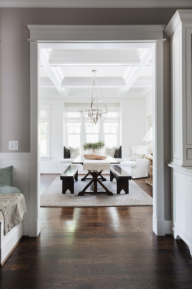 Dining room off kitchen with dining room benches and traditional coffered ceiling This is a large rectangular room filled with windows on three sides Dining room #Diningroom #diningbenches #diningbench #cofferedceiling