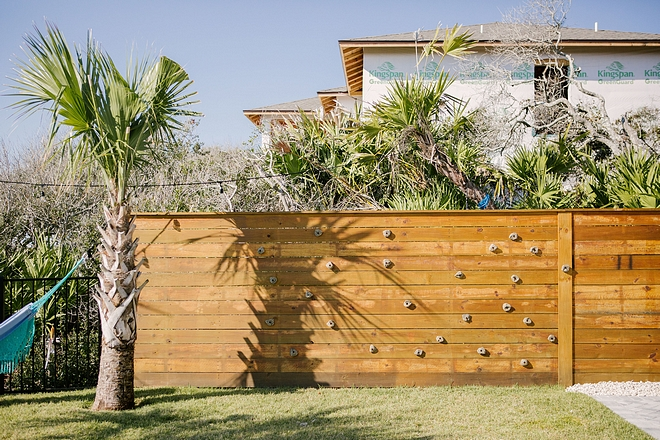 Kids backyard ideas The fence features a DIY rock climbing wall #DIY #rockclimbingwall #backyard