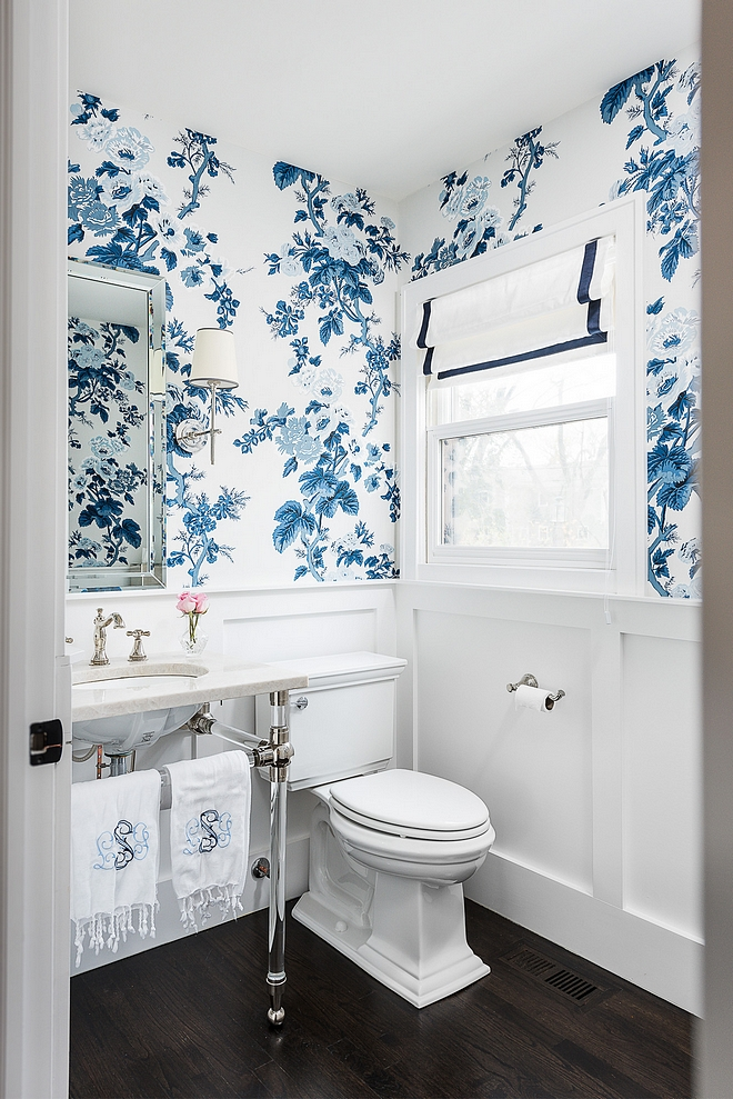 Powder Bathroom Powder Bath features classic wainscoting, blue and white floral wallpaper, acrylic bathroom basin and a dramatic dark hardwood flooring #PowderBathroom #PowderBath #Bathroom #wainscoting #wallpaper