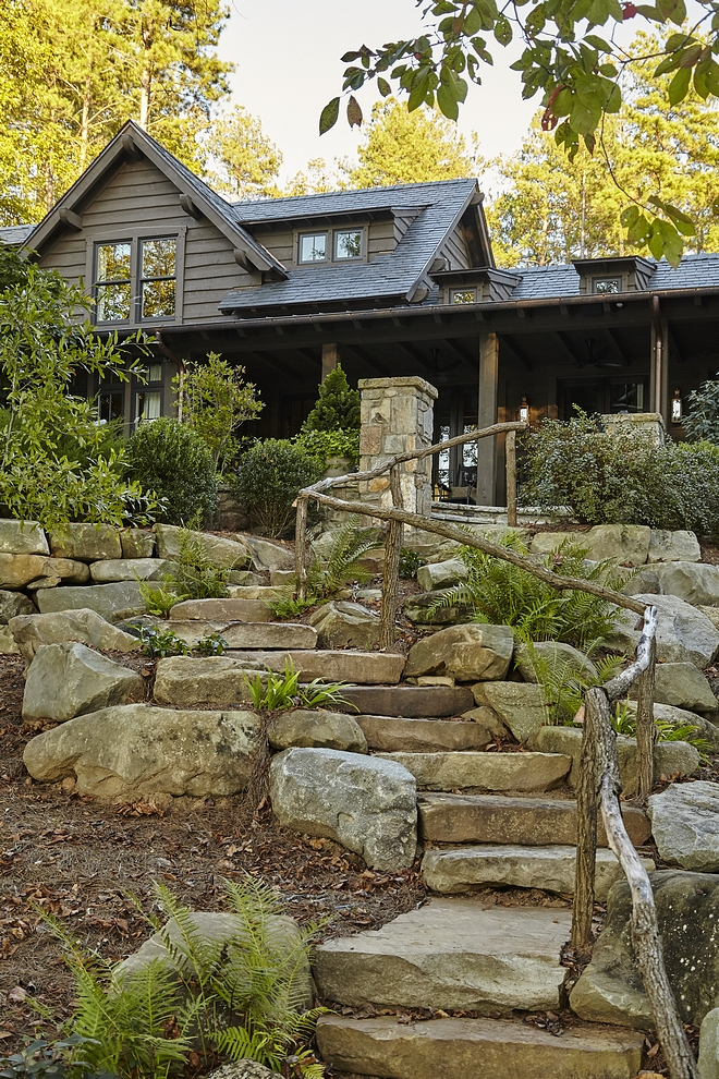 Stone and Pavers Sloping Backyard Stairs I am loving this stone stairway with rustic wood railing Sloping lots Bakcyard stair #stair #backsyard #stonestairs #stonestaircase #woodrailing #rusticrailing #paverstone #paverstaircase