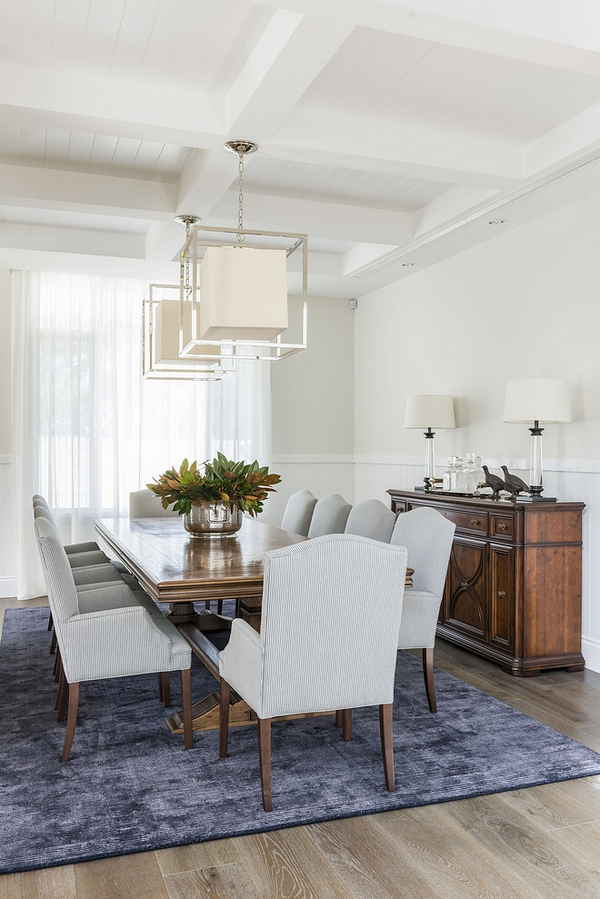 Traditional Dining Room featuring coffered ceiling with tongue and groove, White Oak hardwood floring, chair rail wall trim and a pair of caged lantern pendant lights #diningroom #traditionalinterior #diningrooms