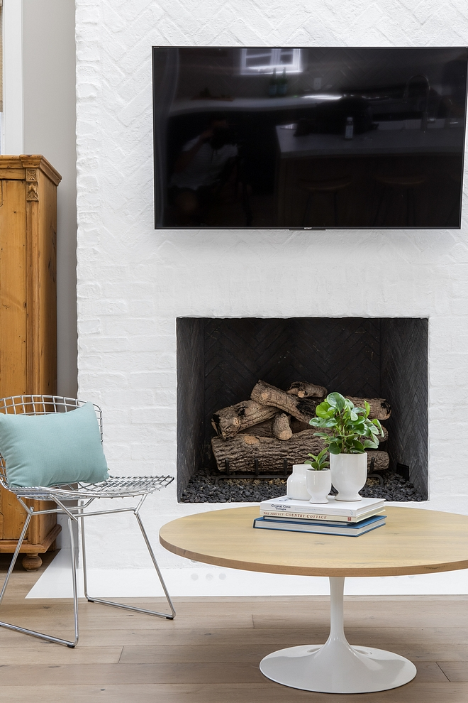 The fireplace brick is laid in a combination of herringbone and brick-style patterns