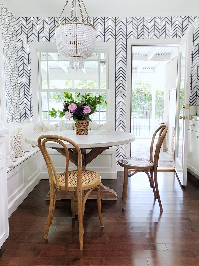 Breakfast Nook Small Breakfast Nook with custom banquette, beaded chandelier, small round table, French bistro dining chairs and chevron wallpaper on walls Breakfast Nook Small Breakfast Nook #BreakfastNook #smallBreakfastNook