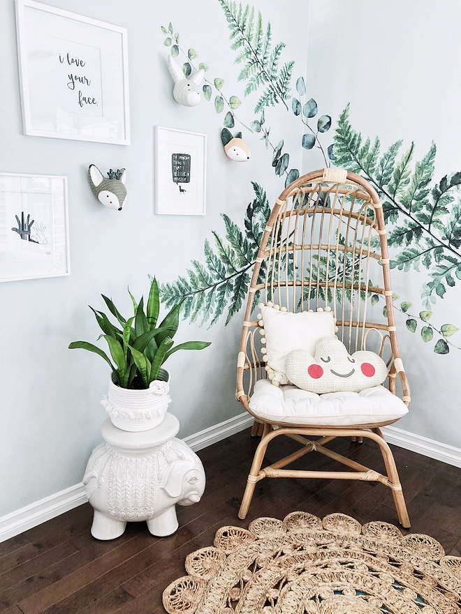 Kids Reading Nook These fern decals make this reading nook a lot of fun for my four-year-old. And while I would have loved a hanging chair, I didn't think it was practical for my boys so I opted for this caged freestanding chair instead #kidsreadingnook #readingnook #diy