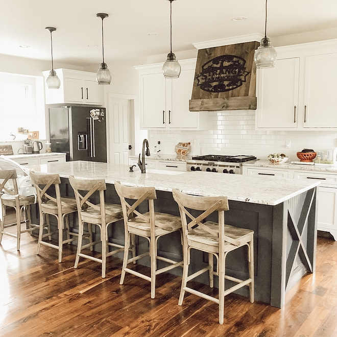 Farmhouse kitchen with white perimeter cabinets and a long farmhouse kitchen island #farmhousekitchen #farmhousekitchenisland #farmhouseisland